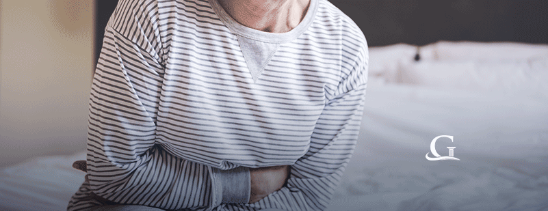 Elderly Woman Experiencing Stomach Pain Stock Photo
